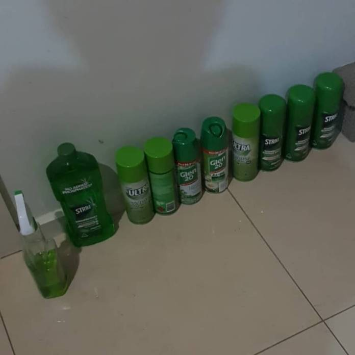 Disinfectant spray at holding area where food is left for collection