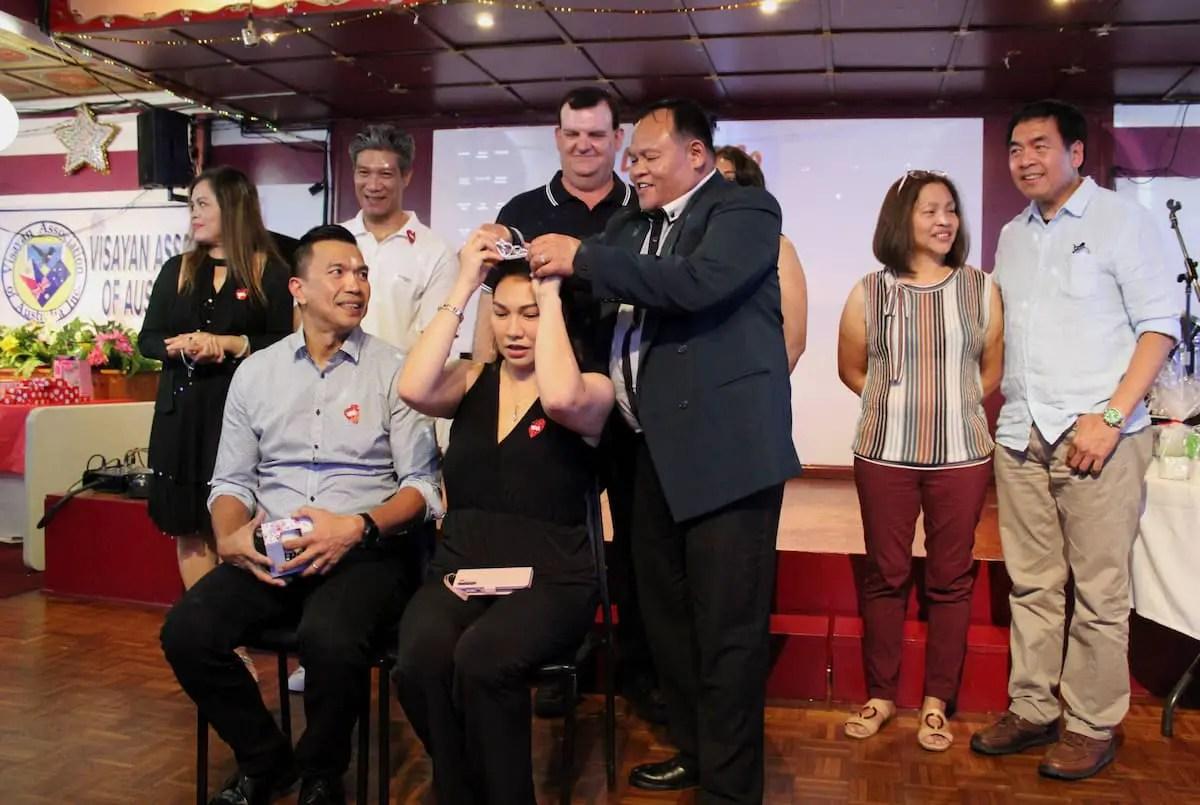 VAA Inc President Jhun Salazar crowns the winners of couple quiz, Julius and Jemina Cotelo