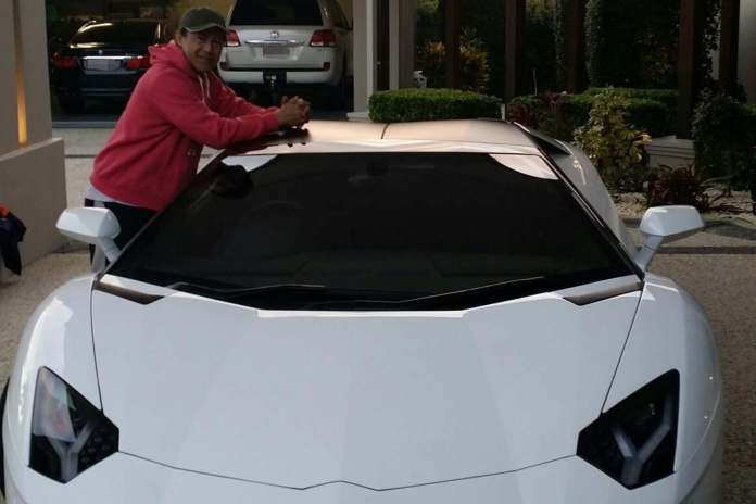 Phil Cabudlan with one of his boss's two Lamborghinis.