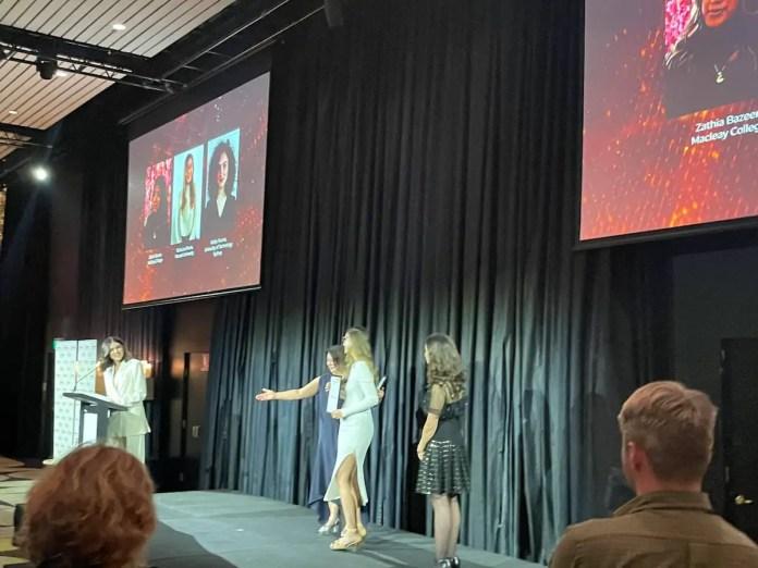 Tricia Rivera receiving the award
