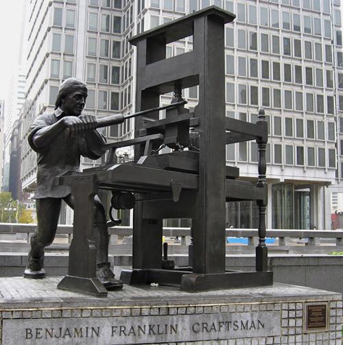 Benjamin Franklin with a printing press. Statue near City Hall, Philadelphia.