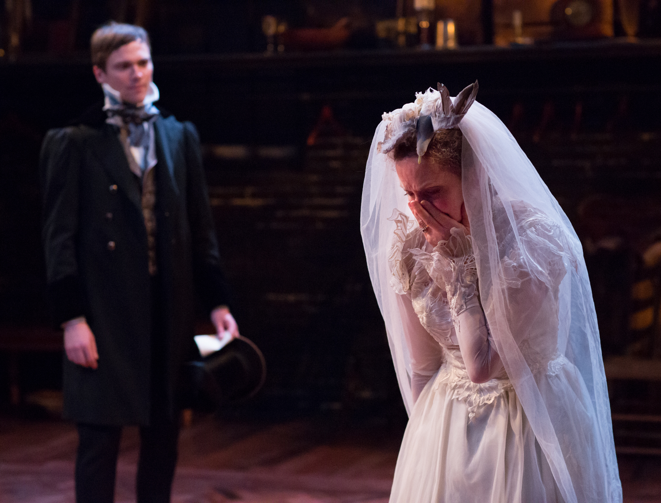Josh Carpenter (left) as Pip and Sally Mercer as Miss Havisham in the Arden Theatre Company's GREAT EXPECTATIONS. Photo by Mark Garvin.
