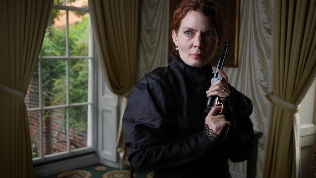 Jennifer Summerfield as Hedda Gabler holding one of General Gabler's pistols. Designer Paul Kuhn created the case for these guns. Photo by Kyle Cassidy.