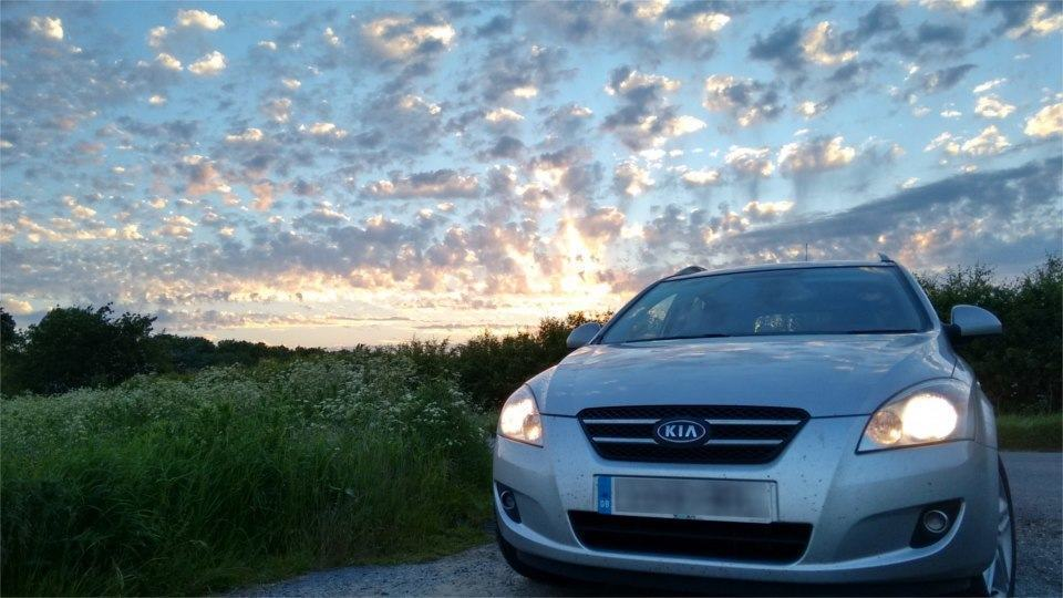 image of car with sunset in background