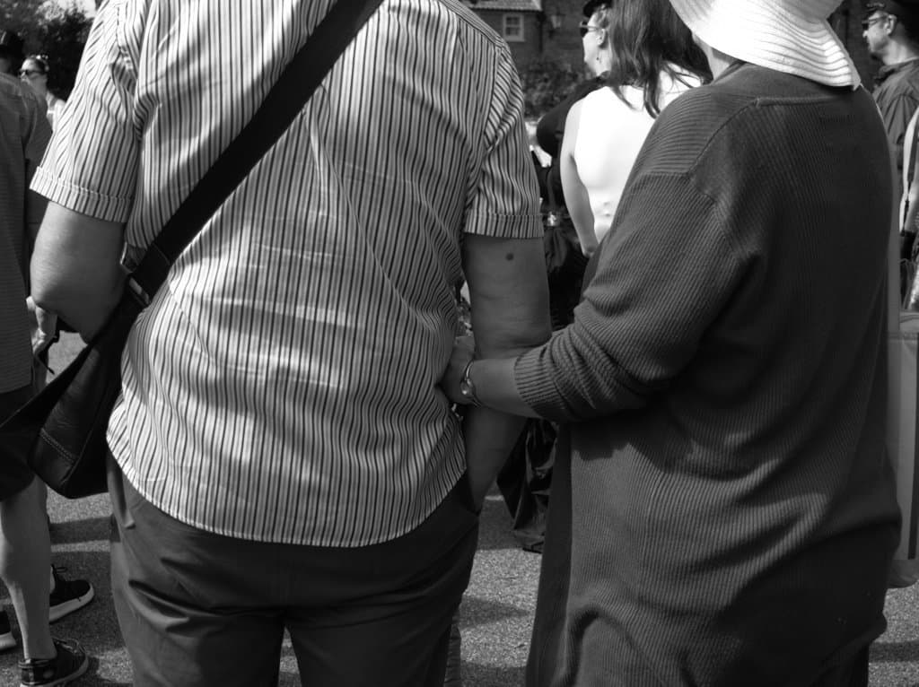 street photography - steampunk sessions couple locking arms