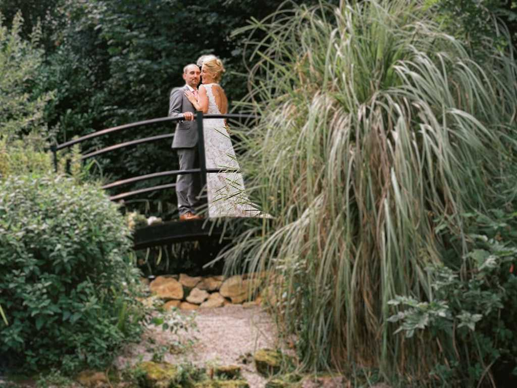 Medium format shot of bride and groom in grounds of hotel