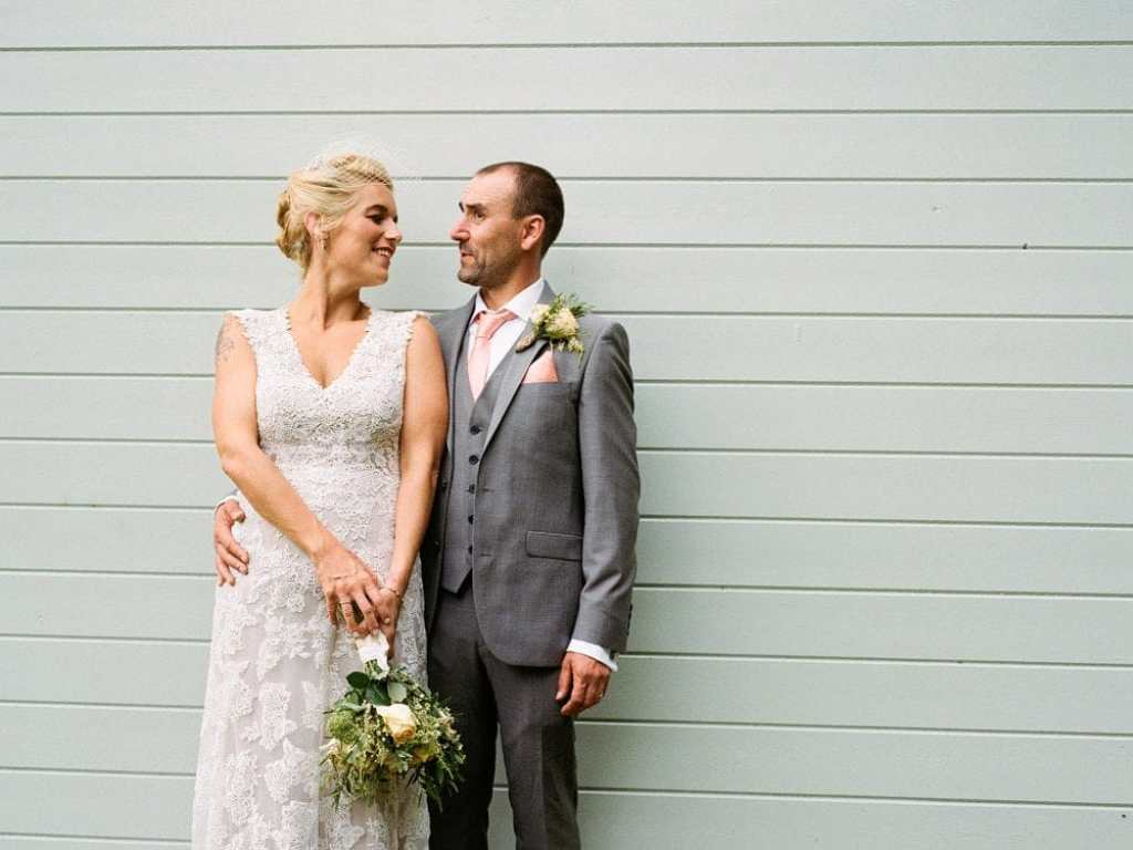 Medium format shot of bridge and groom posing