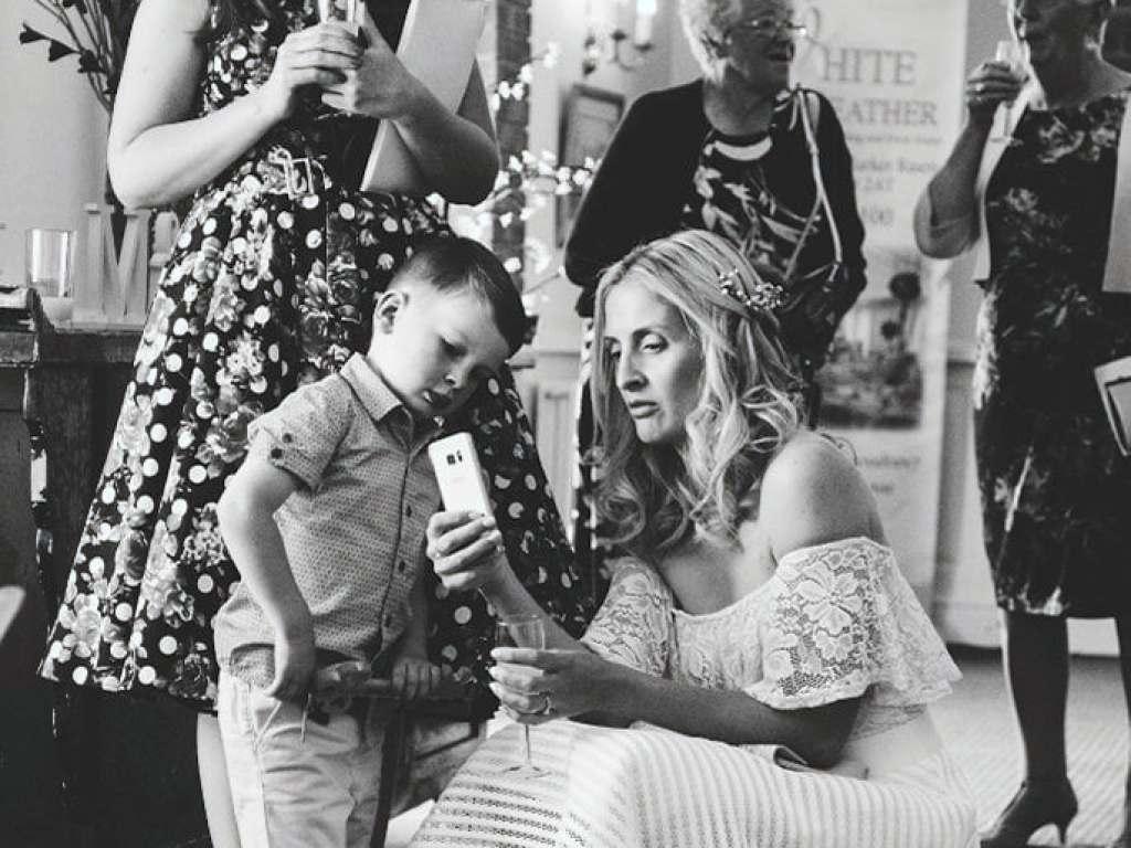 Family showing their phone skills (Nikon D200)