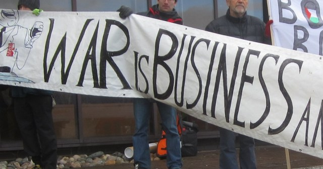 """Banner saying """"War is business"""""""