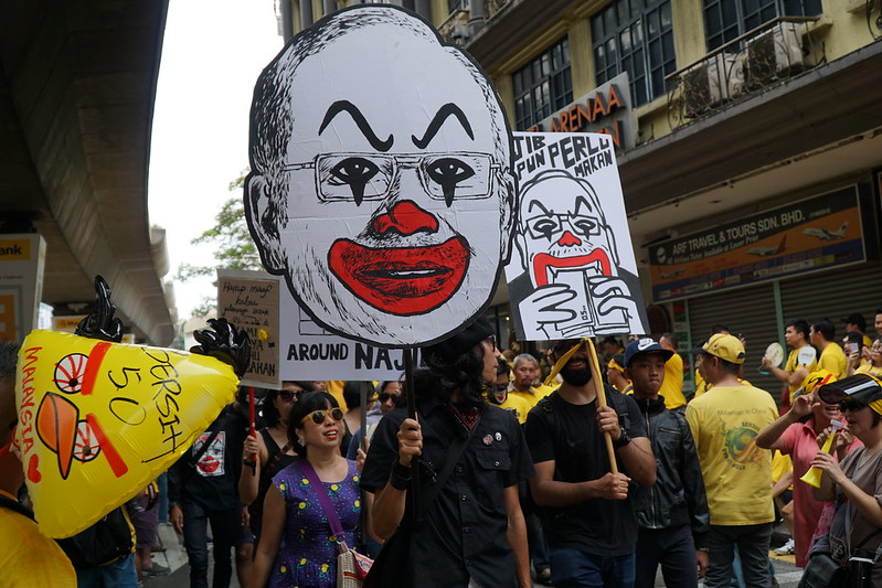 Artist and Activist Fahmi Reza at Bersih 4 with infamous Clown Najib cartoon as placard. Picture by Khairil Yusof @Flickr
