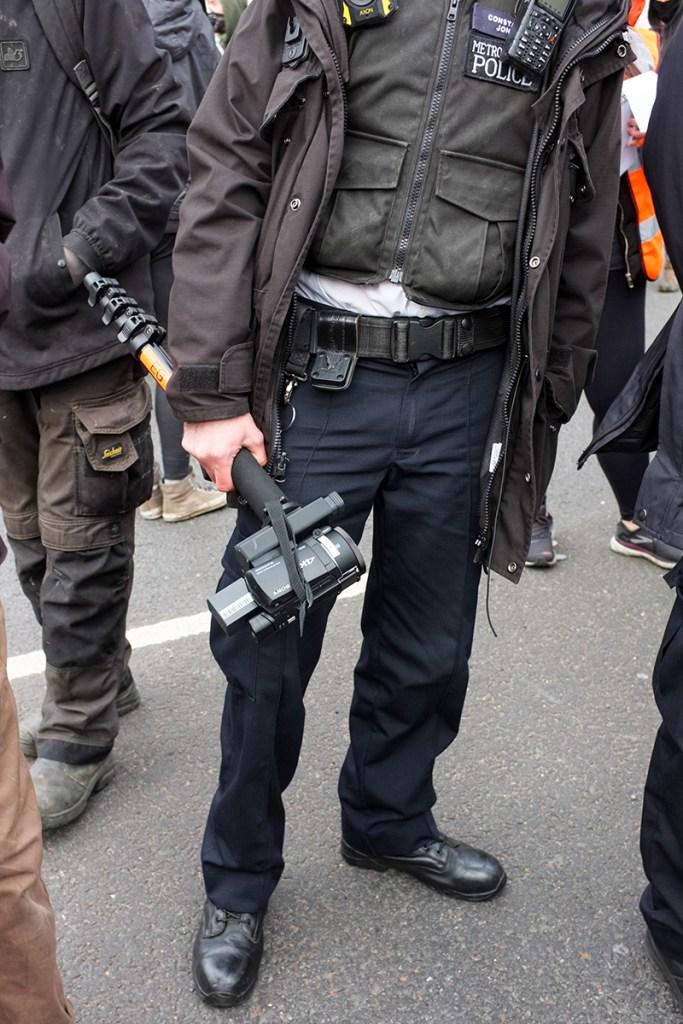 Metropolitan Police officer holding a camcorder