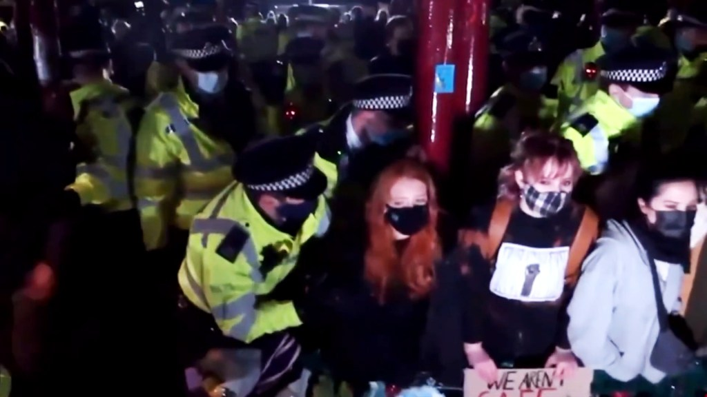 Police surround protesters on Clapham Common bandstand during the vigil for Sarah Everard
