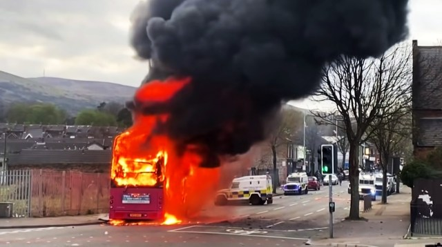 A bus on fire in the middle of Shankill Road, Belfast