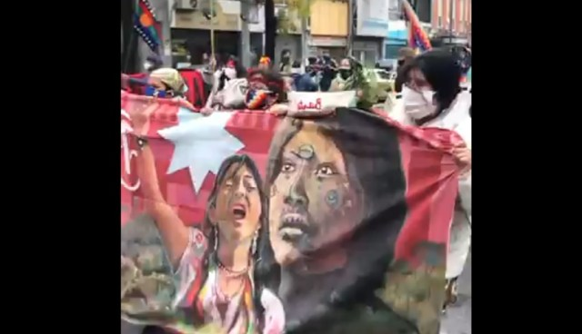 Banner during Argentina protest, showing Indigenous women