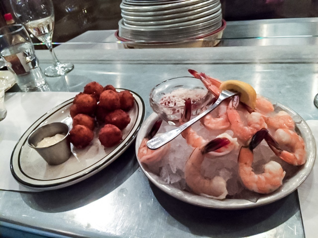Small plates include sweet corn hush puppies and shrimp cocktail.