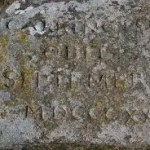 Garden memorial stone carved into