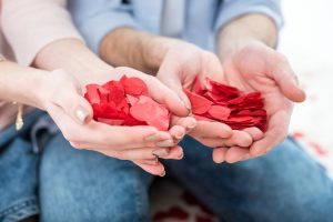 Cheap Romantic Date Ideas in Phoenix Image of male and female hands holding flower petals