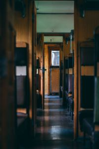 Photo image of the interior of a old fashioned rail car or train
