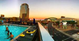 Photo of a pool and bar overlooking downtown