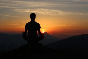 Silhouette photo of a person in a yoga pose