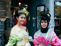 Photo image of two women wearing festive Chinese clothing