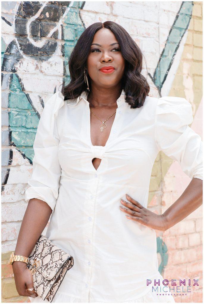 Black woman smiling in white dress