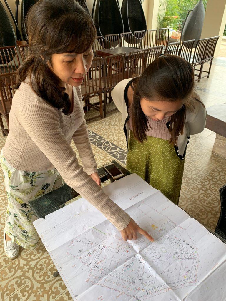 Reading the feng shui master's map, Hanoi, Vietnam ©2019, Cyndie Burkhardt.