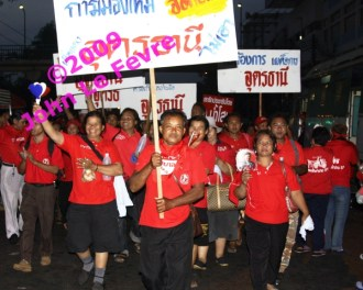 Red-shirt pro-democracy protesters from Udon Thani in Thailand's north arrive at Government House.