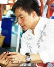 Pheu Thai MP Karun Hosakul backstage at Ratchaprasong intersection - Songkran in Bangkok