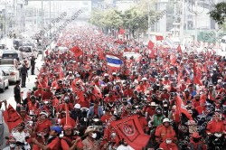 "Invoking the Thailand State of Emergency Act Prime Minister Yingluck said ""one must not impinge on the rights and freedoms of others"". Red-shirt protesters take to the streets of Bangkok in 2010."