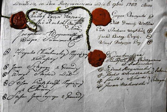 Остання сторінка опису меж села Кугаїв з підписами та скріплена печатками