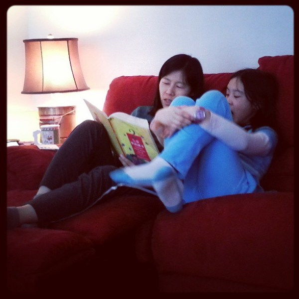 Lily going over Chinese school material with the girl. It's all good, the boy is next.