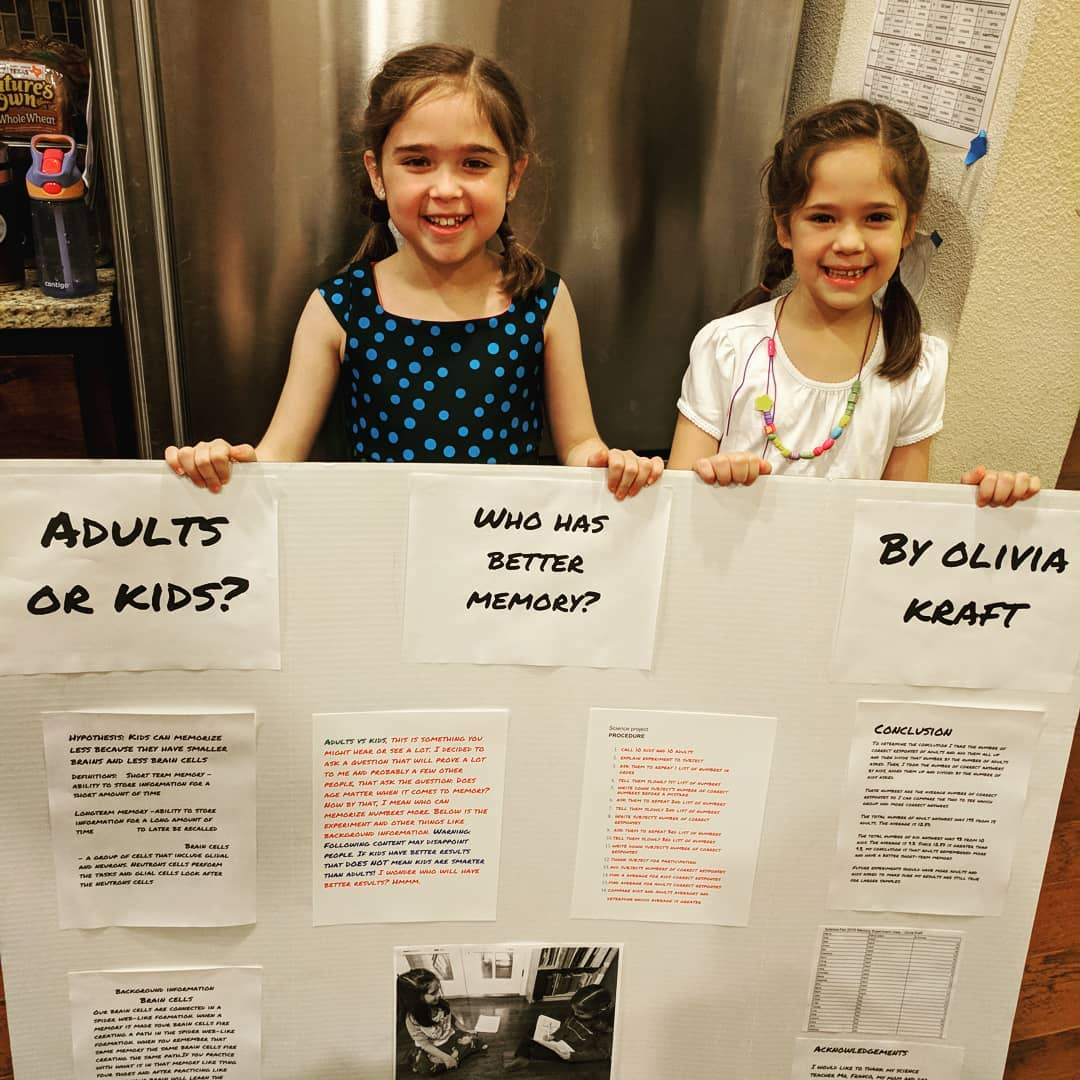 Olivia with her first project board presentation, pictured with her lab assistant, Catalina.