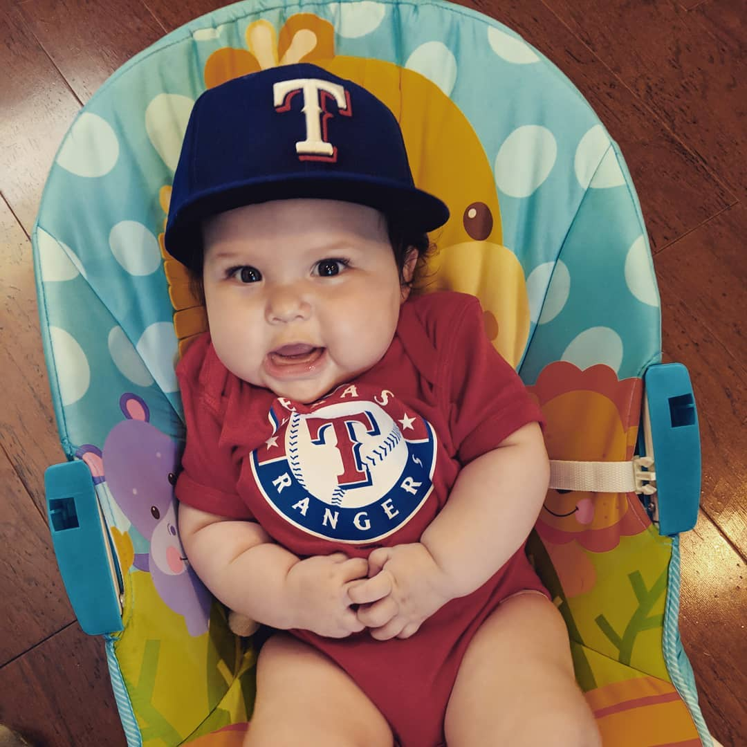 Her @astrosbaseball fan mom and big sister weren't very impressed. Actions speak louder than words and none of our children at this age would wear a hat except Ruth and her @rangers cap