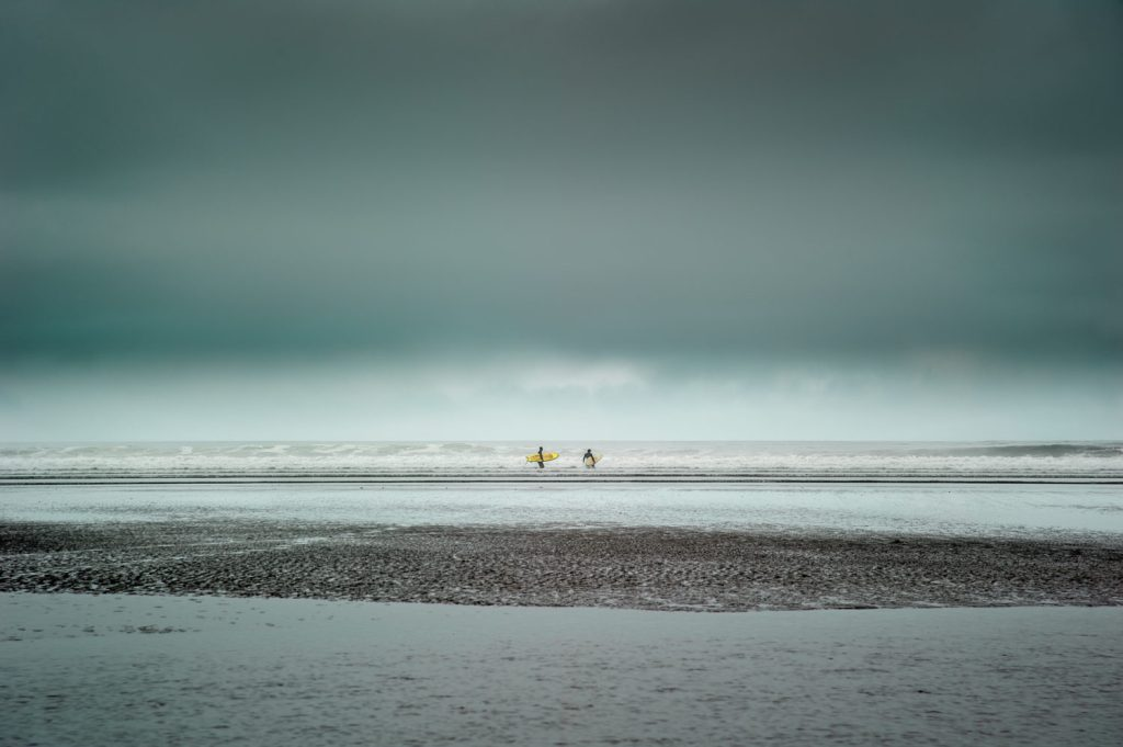 """2nd place, Waterscapes category: """"Two Surfers"""" by Shuwen Lisa Wu"""