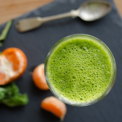 Healthy and refreshing green smoothie with kale, passion fruit and vanilla bean