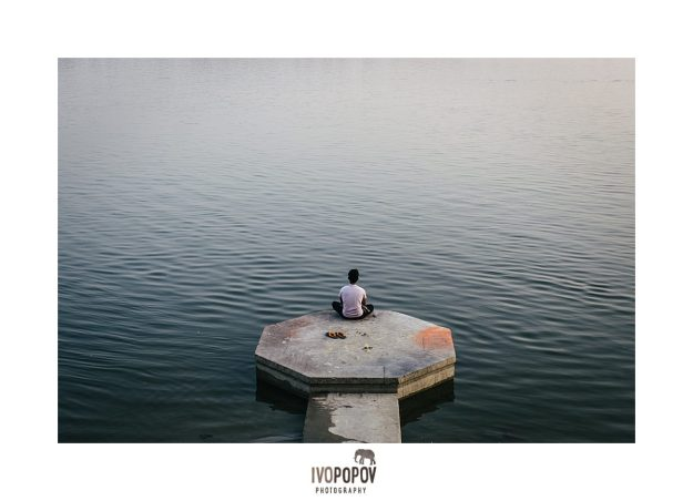 Local man waiting for the sunrise on the ghat in Varanasi.