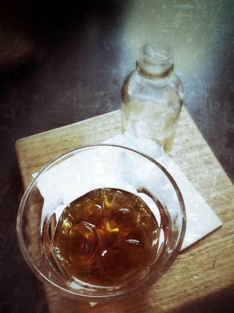 glass of ice and coffee on a wooden board
