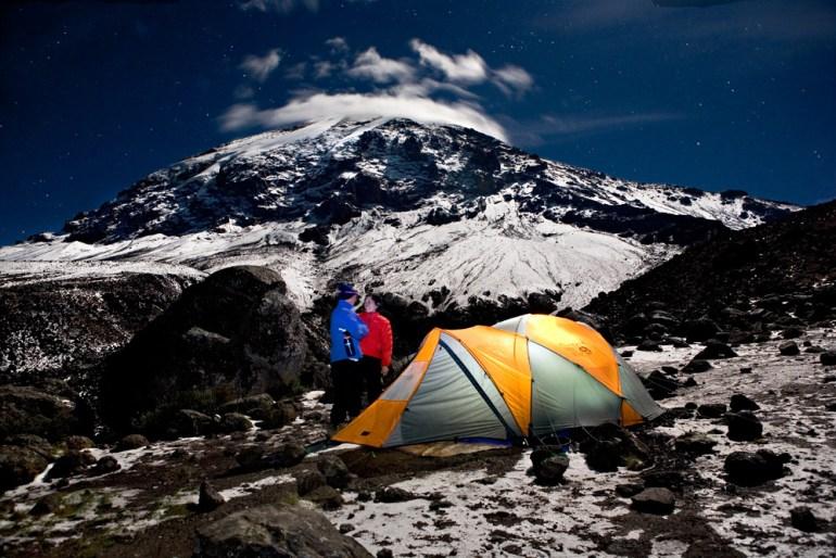tents glowing in the nighttime sky on Kilimanjaro