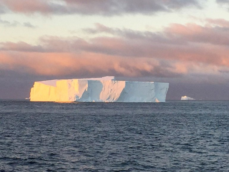 Icerberg in Antarctica at sunset