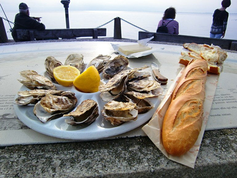 oysters and baguette in normany france