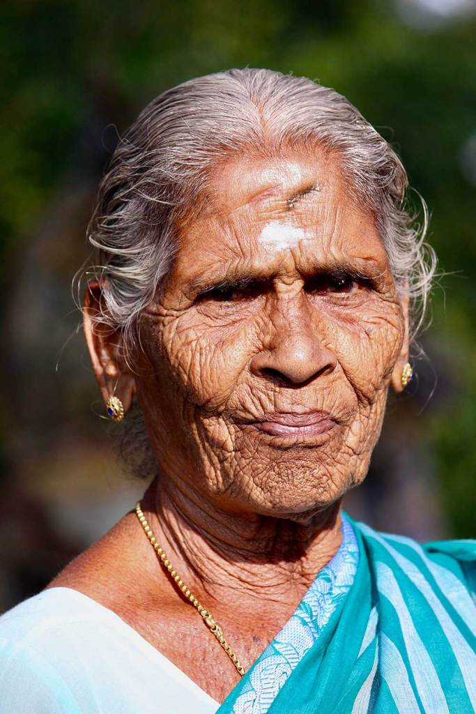 woman at a small temple in Tamil Nadu India