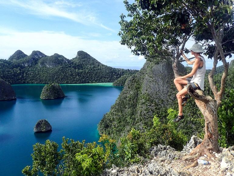 Woman overlooking Raja Ampat Islands
