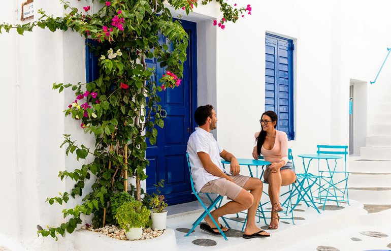 couple sitting a table in greece