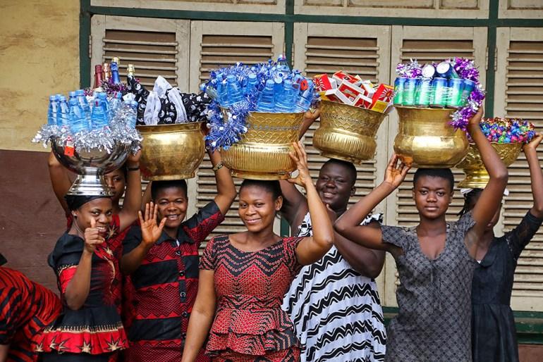 ashanti women carrying gifts for funeral in Ghana