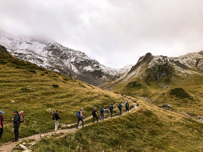 hikers heading into the alps near mont blanc