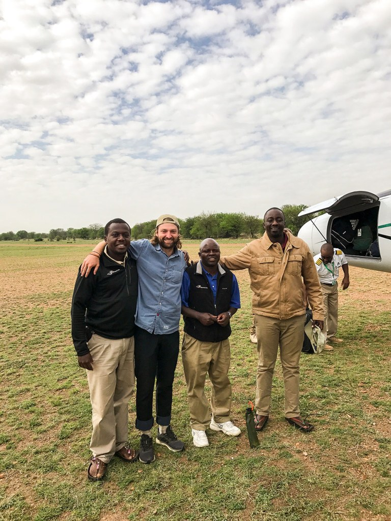 Group photo near a plane in the Serengeti Tanzania