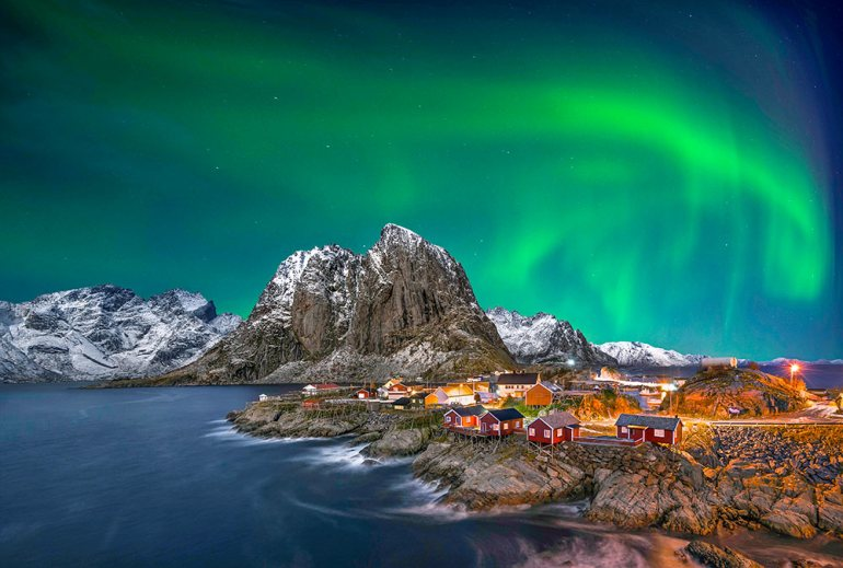 northern lights over town in Norway
