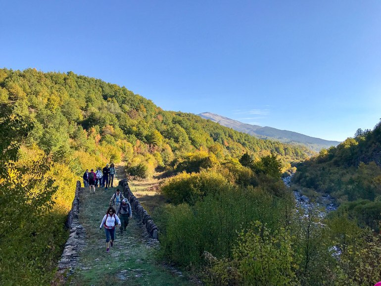 hikers walking on a path in Greece