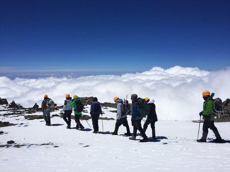 hking through snow in kilimanjaro